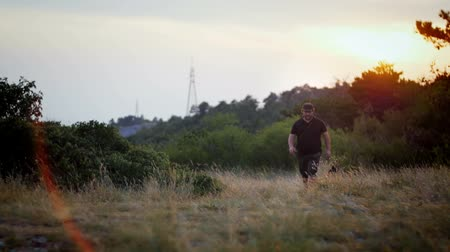 almanca : Owner and german sheper walking in the fields on the sunset Stok Video