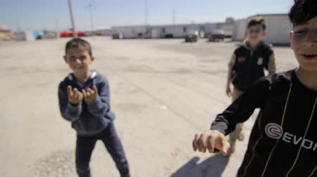 Iraqi Kurdistan IDP kids playing and posing in front of camera Stok Video