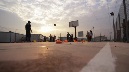 etkinlik : Iraqi Kurdistan IDP camp low angle of girls having physical activity
