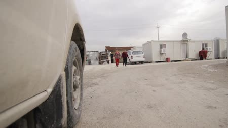 Iraqi Kurdistan IDP camp low angle shot while driving through the internal streets Stok Video