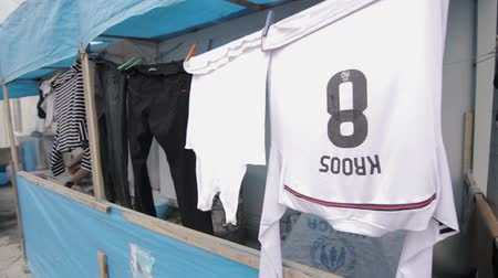 dry zone : Iraqi Kurdistan IDP camp laundry drying and famous football player shirt
