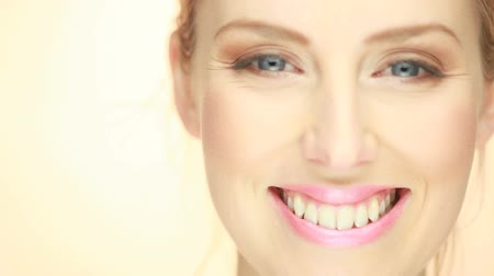уход за кожей : Portrait Of Beautiful Smiling Woman, extreme close up of face.