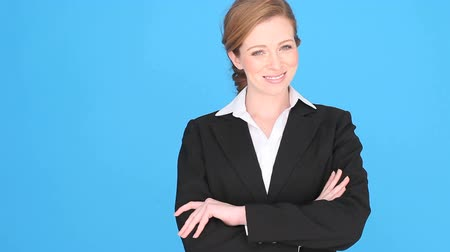 сложены : Smiling confident bussinesswoman or executive upper body isolated on a blue background,