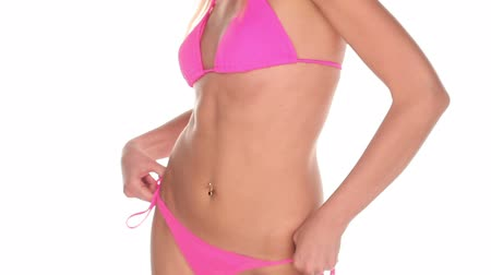 půvabný : attractive young woman in pink bikini on withe screen