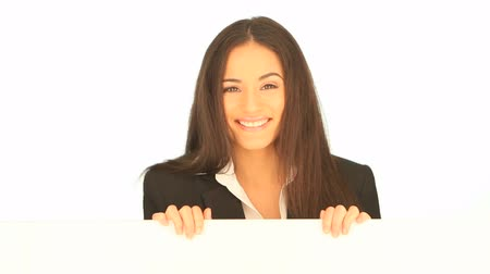 blank : Smiling friendly attractive businesswoman holding a blank white board in her hands for your text or advertisement Stock Footage