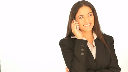 брюнет : Beautiful professional brunette businesswoman using her mobile phone on a white background