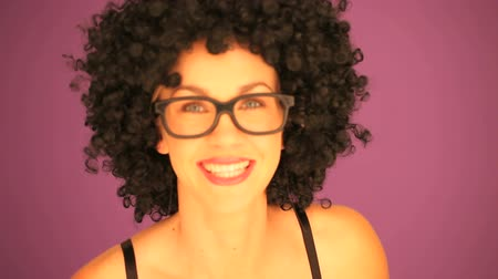 vidro : Beautiful vivacious woman with a black afro hairstyle wearing glasses with an expression of surprise on her face