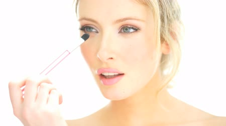 model : close-up blonde woman applying her lipstick makeup on white