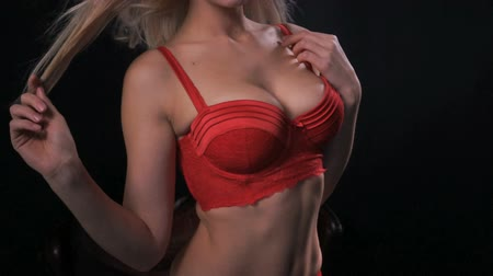 черные волосы : sexy woman wearing red lingerie on black background Стоковые видеозаписи