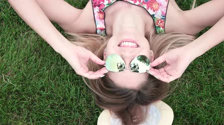 outside : Beautiful Girl Lying on the grass smiling