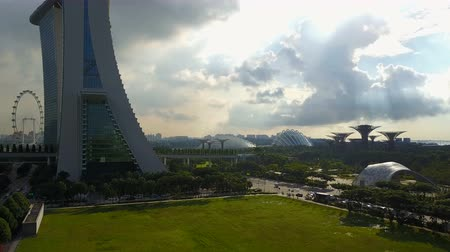 skypark : 4k travelling aerial shot of Marina Bay Sands with Singapore City Skyline as background during cloudy summer day Stock Footage
