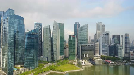 skypark : 4k aerial footage of Singapore skyscrapers with City Skyline during cloudy summer day