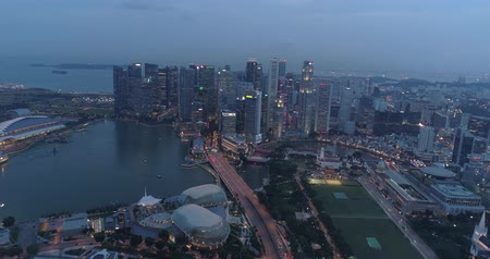 sand bank : 4k aerial footage of Singapore skyscrapers with city skyline during cloudy evening Stock Footage
