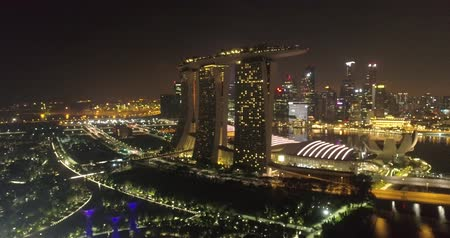 sand bank : Aerial drone view of Singapore Marina Bay at night, Singapore Stock Footage