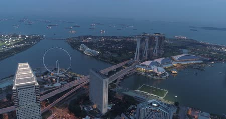 sand bank : Aerial drone view of Singapore Marina Bay during cloudy evening, Singapore Stock Footage