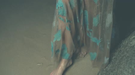 mermaid : Closeup legs of mysterious woman in long dress walking at the beach - video in slow motion Stock Footage