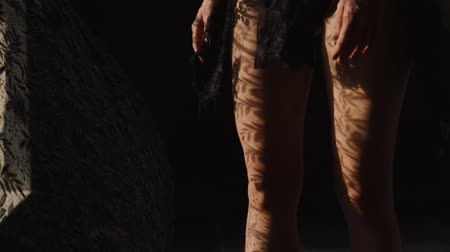 klín : Closeup womans legs wearing red wedges walking. Girl in sandals on platform with lace curtain shadow and sun rays on her legs - video in slow motion