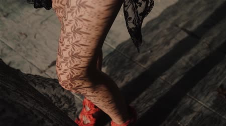 klín : Closeup womans legs standing close to the window with lace curtain pattern shadow and sun rays - video in slow motion