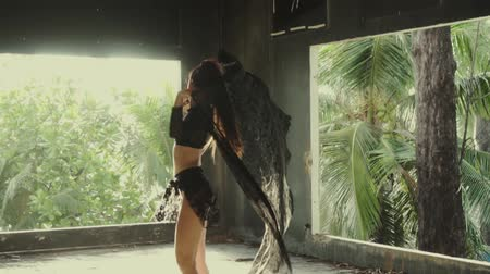 csábító : Beautiful woman playing with lace fabric. Sensual girl dancing in abandoned building - video in slow motion