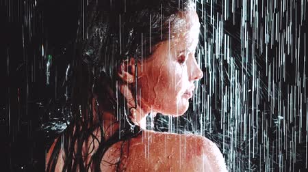 seduce : Closeup of beautiful woman taking outdoor shower at night - video in slow motion