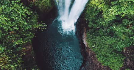 stoned : Aerial drone view of beautiful Aling Aling waterfall in nothern Bali, Indonesia