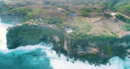 falsificação : Aerial drone view of temple and beautiful Uluwatu cliffs in Bali, Indonesia Stock Footage