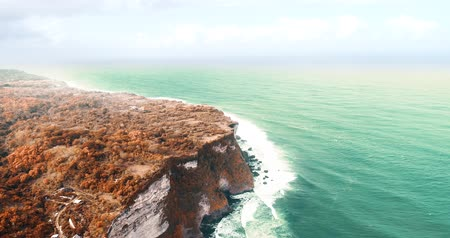 falsificação : Aerial drone view of beautiful Uluwatu cliffs in Bali, Indonesia Stock Footage
