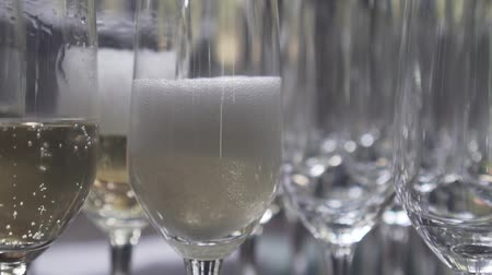 hiss : Closeup of pouring champagne into the glass - video in slow motion Stock Footage