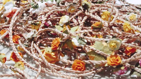 segregatory : Closeup floral wreaths on the table. Summer party concept
