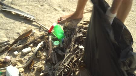 rubbish : Closeup hands of woman tourist cleaning the beach on her holiday Stock Footage