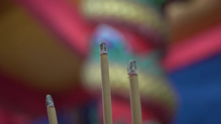 taoism : Closeup of burning incense sticks in Chinese temple, Thailand