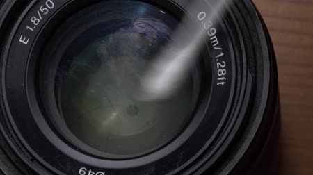 mirrorless : Macro closeup of cleaning cameras lens with cotton pad - video in slow motion Stock Footage