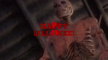 sahte : HAPPY HALLOWEEN - text animation with red letters over fake human skeleton background Stok Video