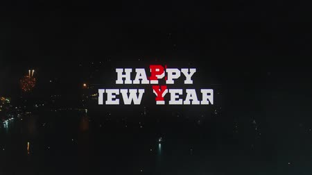 毎年恒例の : HAPPY NEW YEAR! - text animation with red and white letters over real fireworks background