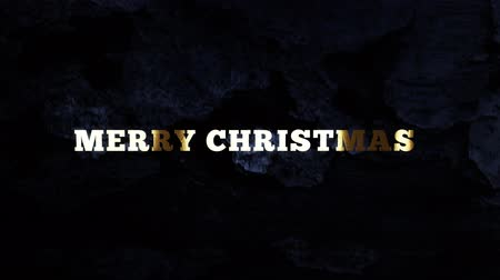 полночь : MERRY CHRISTMAS - text animation with gold letters over dark background Стоковые видеозаписи