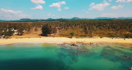 korall : Aerial drone view of beautiful tropical island with sandy beach and green mountains. Summer and travel vacation concept