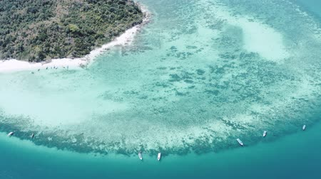 kalker : Aerial drone view of beautiful tropical Bamboo Island white beach with boats in Thailand