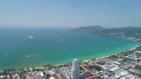 zumbido : Aerial drone view of Patong City, the beach and the bay during sunny day in Phuket, Thailand Vídeos