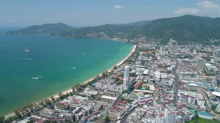 изумруд : Aerial drone view of Patong City, the beach and the bay during sunny day in Phuket, Thailand Стоковые видеозаписи