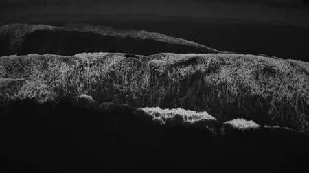 areias : Black and white footage top aerial cinematic view of sea ocean waves and the beach