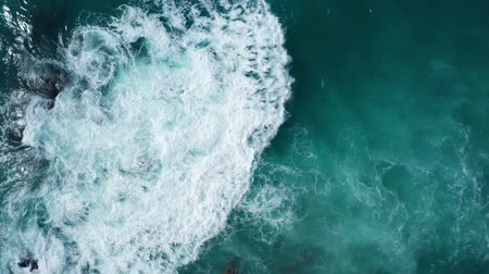 oceanos : Aerial drone top view of oceans beautiful waves crashing on the rocky island coast