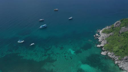 Aerial drone view of lagoon sea water surface with boats near  beautiful Koh Tao island in Thailand Стоковые видеозаписи