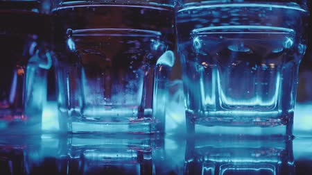 discotheque : Slow motion empty glasses and steam from dry ice on the bar in the night club