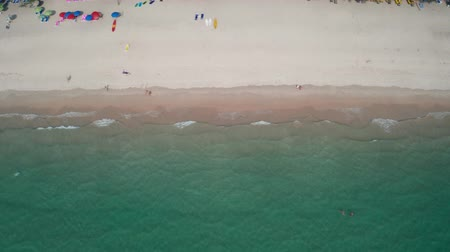 recife : Aerial drone top view of sea waves crashing against the sandy beach