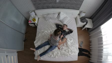 любовь : Young couple in love lying in bed. top view Стоковые видеозаписи