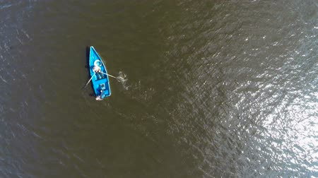 стрельба : two people floating on a boat on the river. aerial view