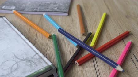 скрепки : Back to school concept. 4k. Panning shot of a school desk with different colorful supplies. Pencils, books etc.
