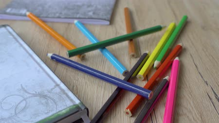 borracha : Back to school or workspace colorful stationery overhead on wood background flat lay slow panning. Stock Footage