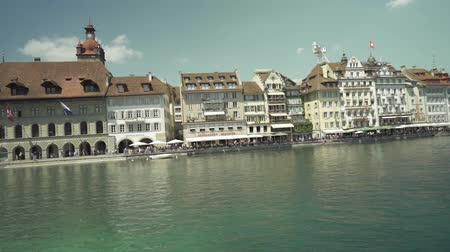 suisse : View of building along the Reuss River on sunny day, LUCERNE, SWITZERLAND 4K UHD Stock Footage