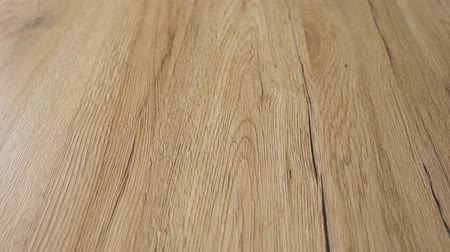 acabado : very close 4k video clip of wood floor sanded and refinish in clear natural color